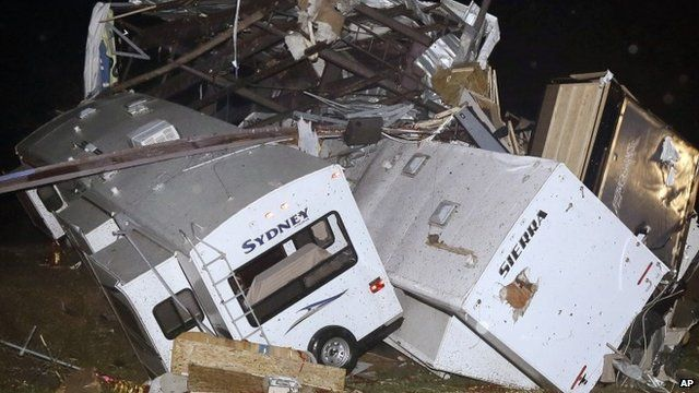Travel trailers and motor homes are piled on top of each other at Mayflower RV in Mayflower, Ark., Sunday, April 27,