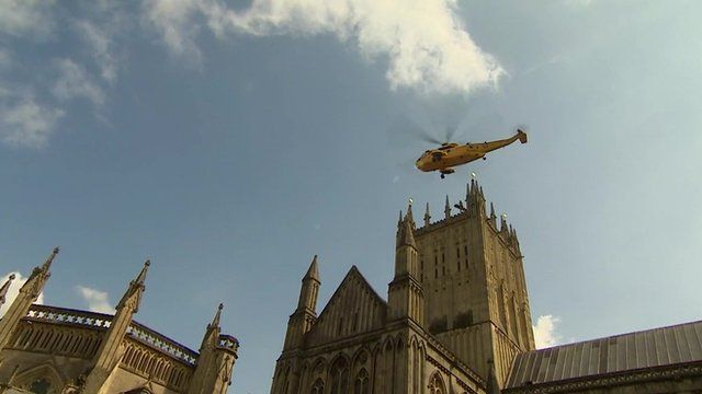 A helicopter airlifting the woman from the roof