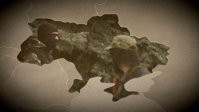 Map of Ukraine with image of masked militia inside.