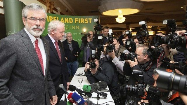 Sinn Fein President Gerry Adams arrives at a news conference after he was released from police detention, in Belfast, May 4, 2014