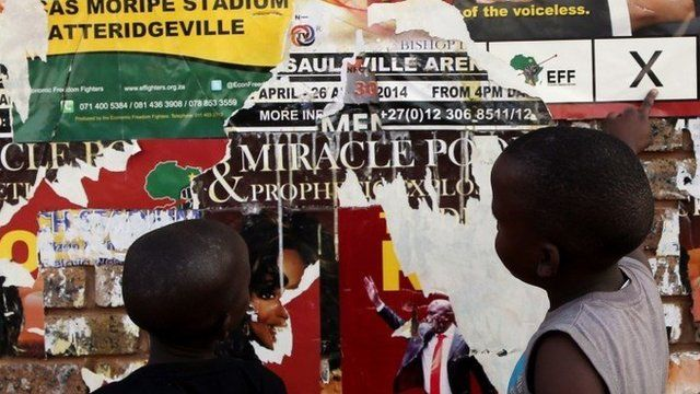 Young boys look at Economic Freedom Fighters (EFF) election posters in Atteridgeville, west of Pretoria, South Africa, 5 May 2014