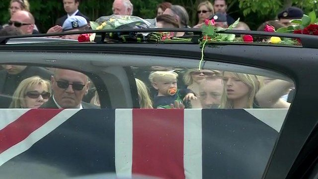 Bouquets placed on top of hearse