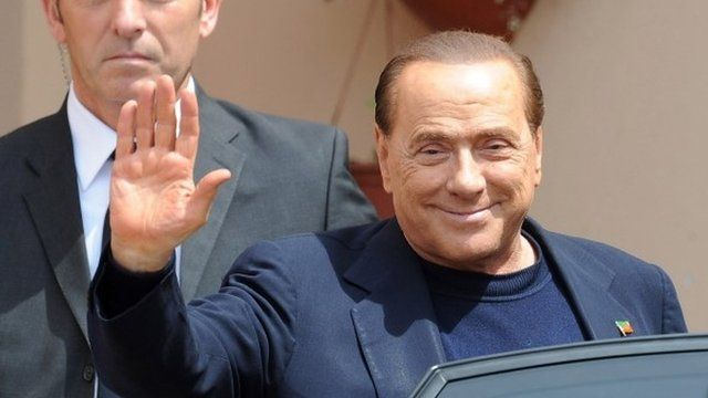 Silvio Berlusconi getting into car after his first day of community service