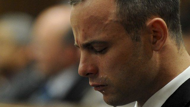Oscar Pistorius weeps in the dock during his trial at the North Gauteng High Court in Pretoria, May 12, 2014