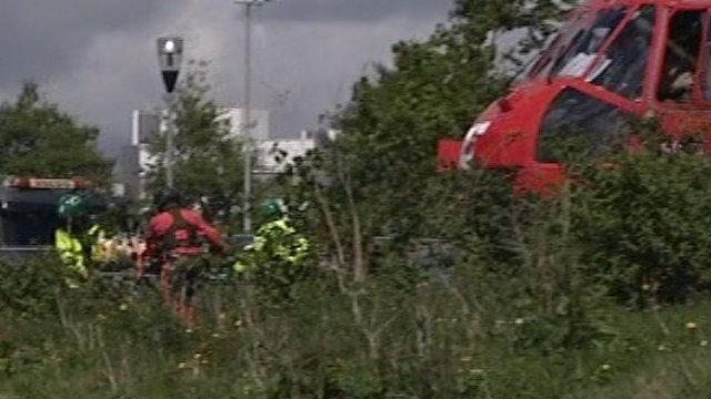 A victim of the Looe coach crash is taken to hospital