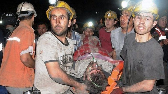 Rescuers carry out a miner in Soma, Manisa, Turkey, on 14 May 2014