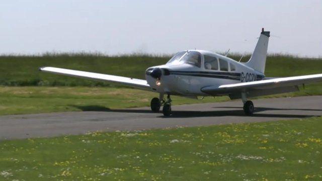 Cliff Parisi's plane touching down