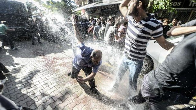 Turkish riot police use water cannons against protesters in Soma on 16 May