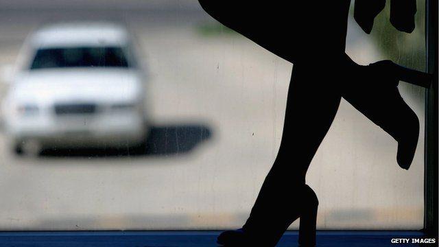 Silhouette of a prostitute in a window