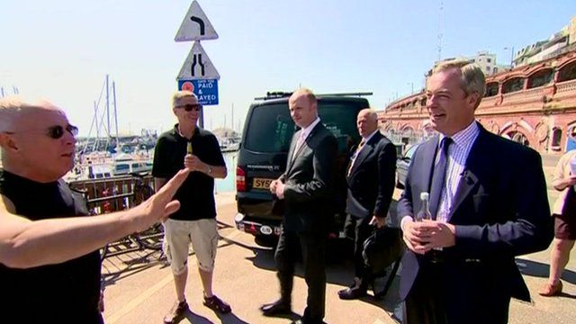 Nigel Farage talks to voter