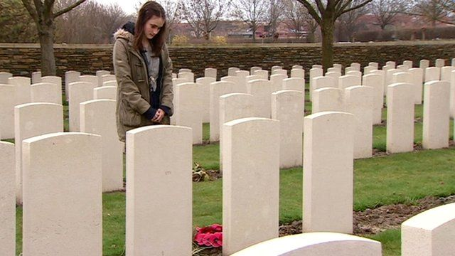 Charlotte praying by relative's grave