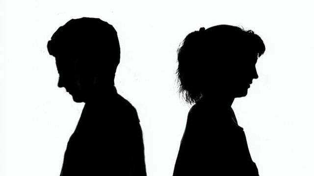 An arguing couple in silhouette