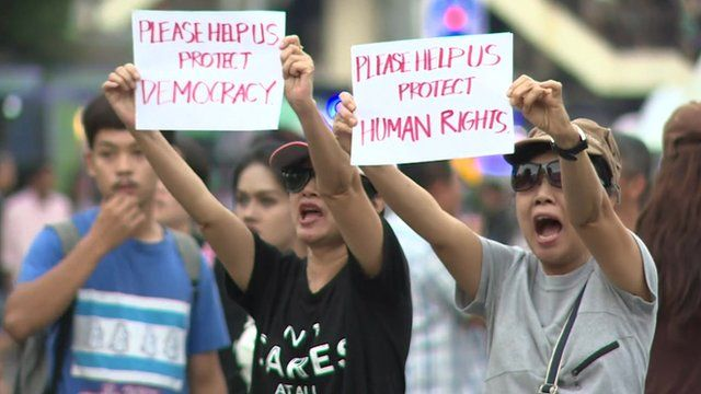 Protesters holding messages in English
