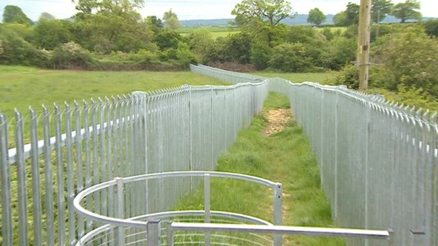 The metal fence dividing a field in Frome