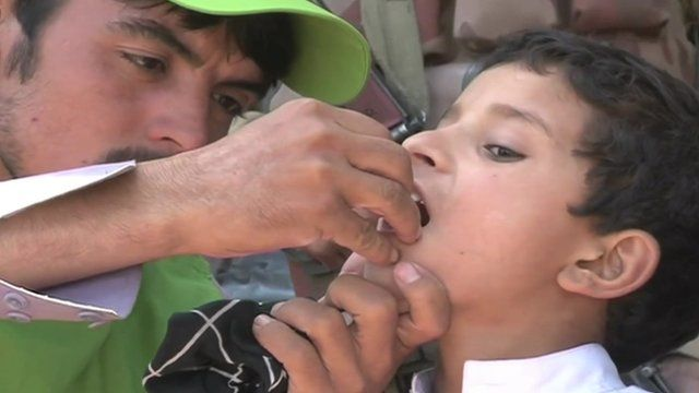 A boy being vacinated