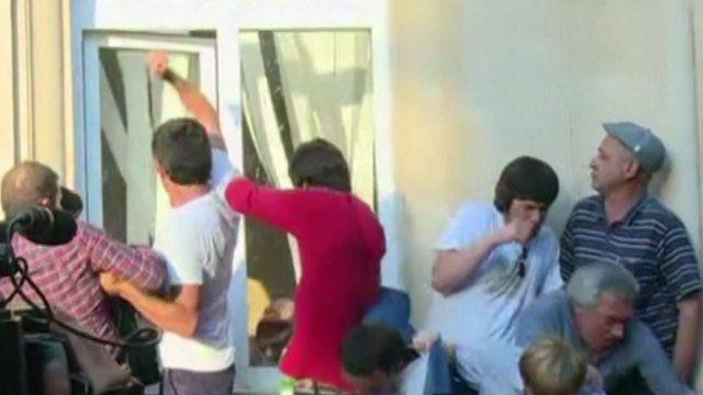 Men breaking into the president's office