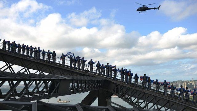 Rotary members and friends climb Sydney Harbour Bridge in an attempt to break the record for the most people on the bridge at one time and also the most flags on the bridge at one time in Sydney on May 30, 2014