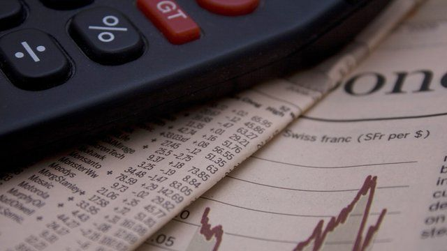 A calculator and financial newspaper