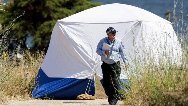 Scotland Yard detective works on an area in Praia da Luz