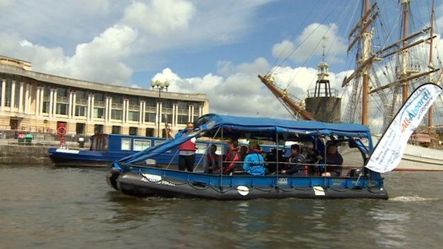 Baton arriving in Bristol on a boat