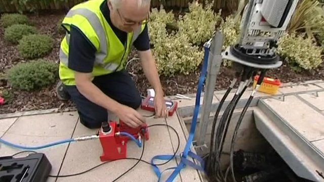 A engineer working on fibre optic cables