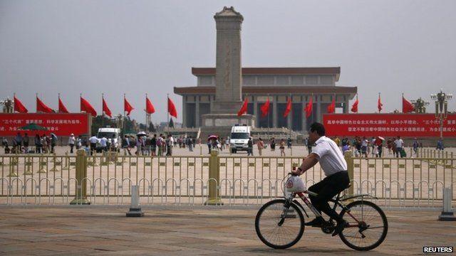 Man on bike at Tiananmen Square