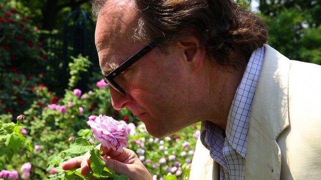Andrea Di Robilant smelling a rose