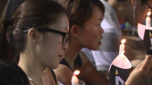 A woman at the vigil
