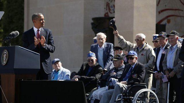 Obama applauds