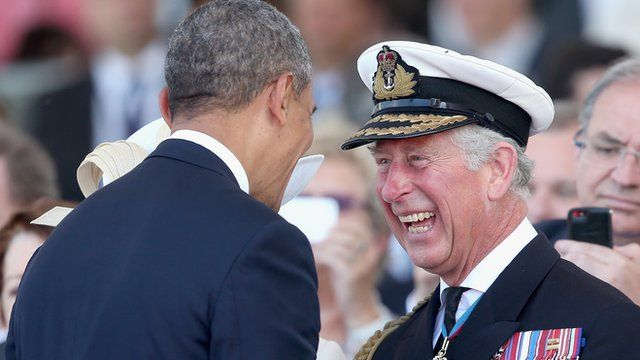 President Obama laughing with Prince Charles