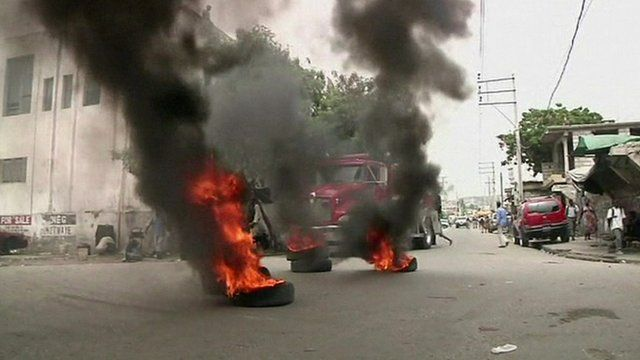 Burning tires on a road in Port-au-Prince