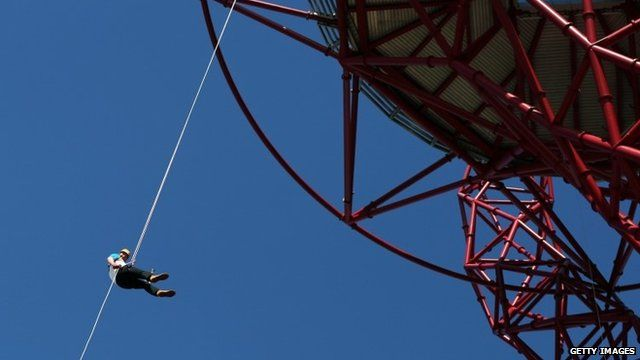 Sir Matthew Pinsent abseils from the ArcelorMittal Orbit