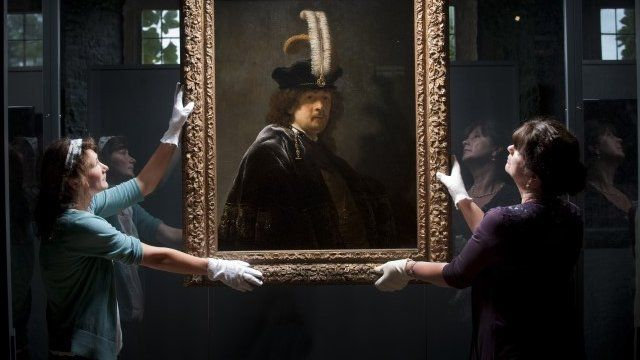 Rembrandt self-portrait being held