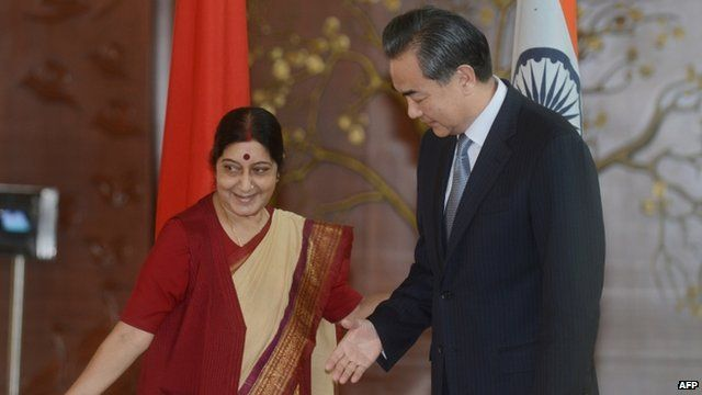 Chinese Foreign Affairs Minister Wang Yi is welcomed by Indian Minister for External Affairs Sushma Swaraj
