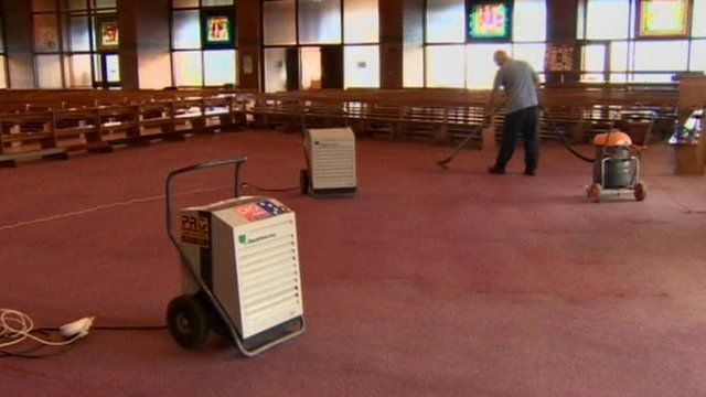 Volunteers help with the cleanup at the church