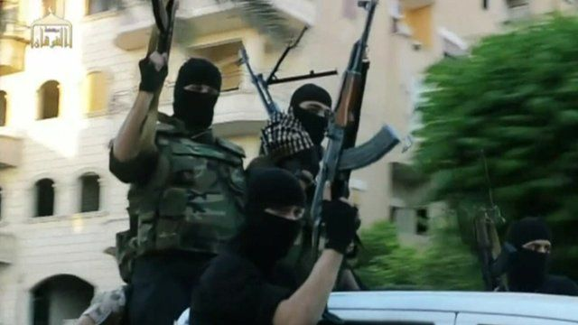 Picture from ISIS film of fighters in balaclavas holding guns