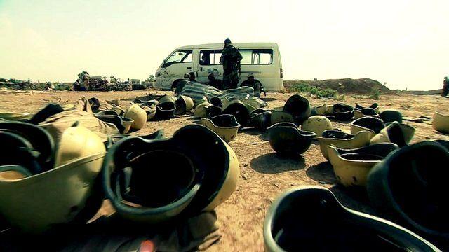 Abandoned Iraqi army helmets