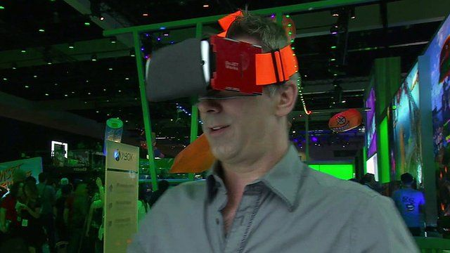 Spencer Kelly wears a virtual reality headset which uses a smartphone as the screen