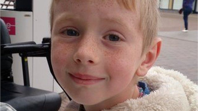 Logan Crawford, who was seven, died after falling from cliffs in Ballycastle
