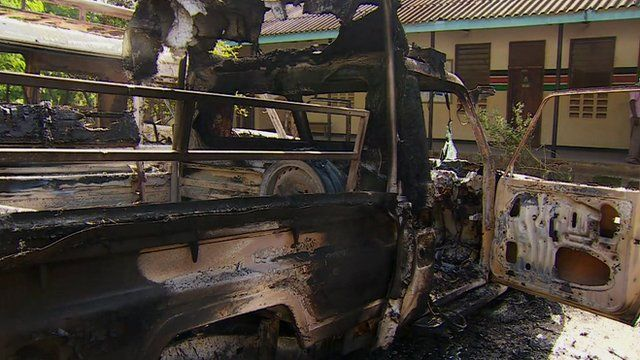 Burnt out vehicle in aftermath of al-Shabab attack