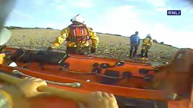 The man talks to the lifeboat crew