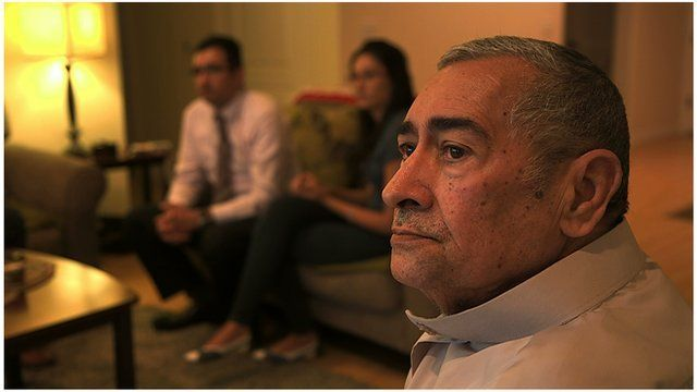Ali Abu Khumra watches a news story about violence in Iraq with his children Tariq Abu Khumra and Sally Abu Khumra in their apartment in Glendale, California.