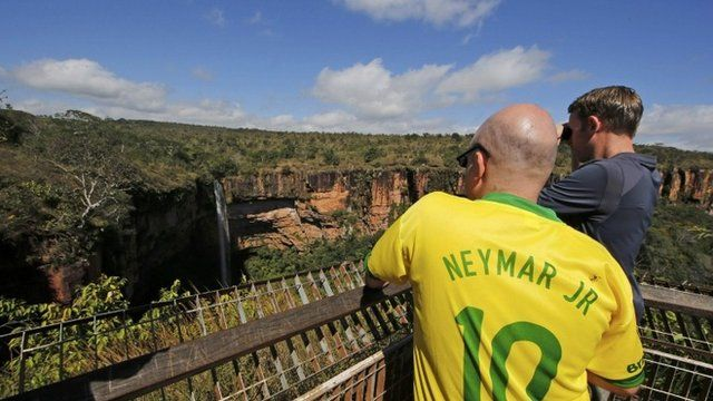 A British fan wearing a Neymar jersey looks at a waterfall in Chapada dos Guimaraes National Park near the World Cup host city of Cuiaba, June 19, 2