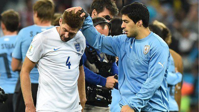 Luis Suarez consoles Steven Gerrard