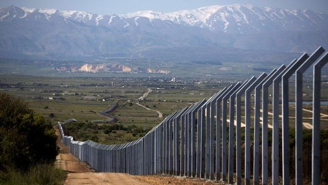 The Israeli border with Syria is seen on the Israeli side of the annexed Golan Heights near Quneitra on April 24 201