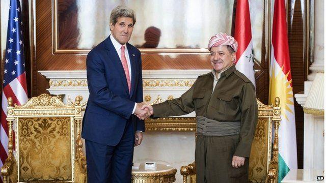 Kurdish President Massoud Barzani, right, shakes hands with US Secretary of State John Kerry
