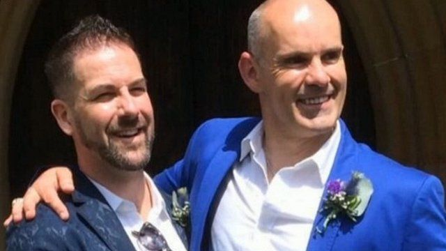 Reverend Andrew Foreshew-Cain (right) with his husband