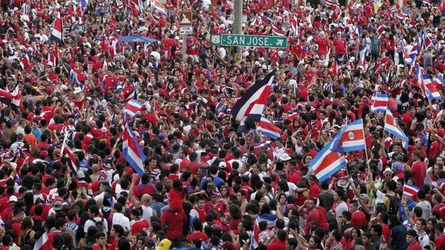 Thousands of Costa Ricans fans celebrate their team defeat of Greece in their 2014 World Cup round of 16 soccer match, in San Jose June 29, 2014