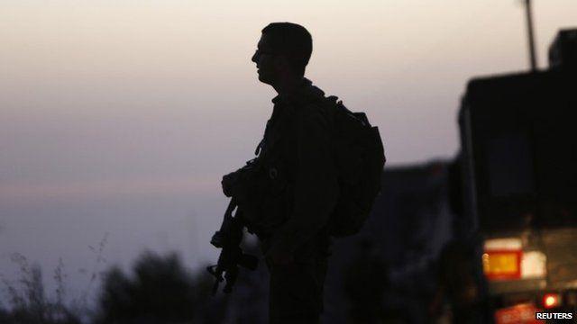 Israeli soldier stands guard in Hebron