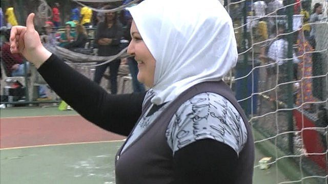 Syrian refugee woman as goal keeper